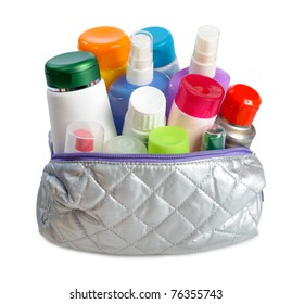 set of  cosmetics in silver cosmetics bag on white background