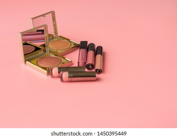 Set of  Cosmetics: Various of  Lipstics, make up Illuminate Cheeks on a Pink Background. Top View. Copy Space for text