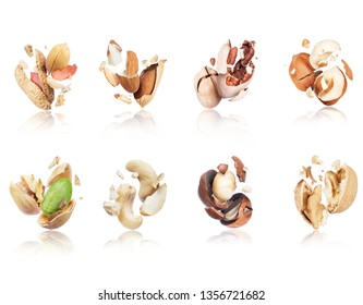 Set of cracked nuts close-up on white background