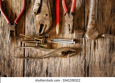 The set of Craftsman tool on the old wooden board, top view