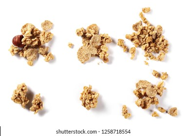 Set crunchy granola, muesli pile with nuts isolated on white background, top view