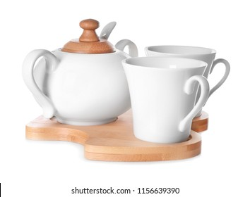 Set of cups with sugar bowl on white background