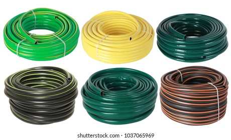 Set of curled plastic  garden water hoses (pipes) isolated on white
