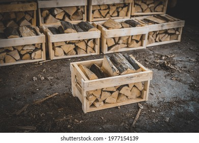 Set of cut firewood. Firewood in wooden crates. Piles of firewood