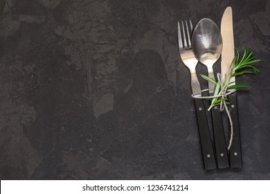 set of cutlery fork, spoon, knife (vintage). Black background. Top view . Copy space.