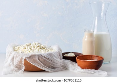Set of dairy products on light blue background. Fresh homemade cottage cheese, sour cream, mascarpone and russian fermented baked milk Ryazhenka