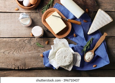 Set of dairy products on wooden table top view