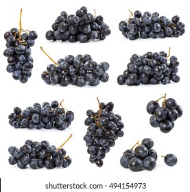 Set of dark grapes isolated on white background
