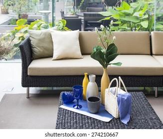 set decoration with wicker sofa