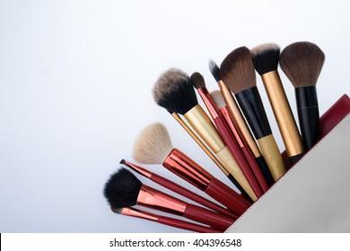 Set of decorative brush cosmetics on white background
