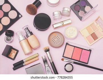 Set of decorative cosmetic. Face powders, concealer, eye shadow blush, foundations. Pink background.