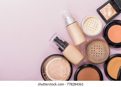 Set of decorative cosmetic. Face powders, concealer, eye shadow blush, foundations. Pink background