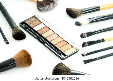 Set of decorative cosmetic powder, concealer, eye shadow brush and blush. Makeup products with cosmetic. Close up shot.