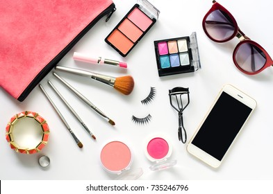 Set of decorative cosmetics and accessories for women on white background