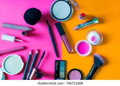 Set of decorative cosmetics blush,powder,mascara and lipstick on color background.
