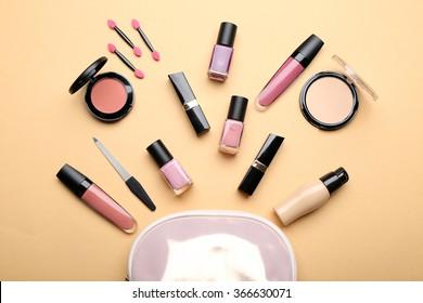 Set of decorative cosmetics on light color background