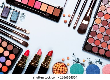 Set of decorative cosmetics on a pastel blue background. Flat lay, top view.