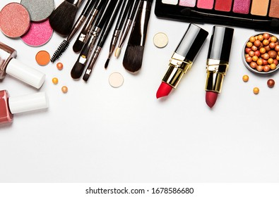 Set of decorative cosmetics on a white background. Flat lay, top view.