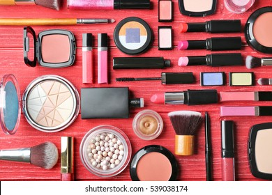 Set of decorative cosmetics on wooden table
