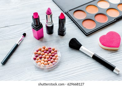 set of decorative cosmetics on wooden background