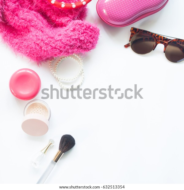 set of decorative cosmetics and woman essentials in pink color collection on white background