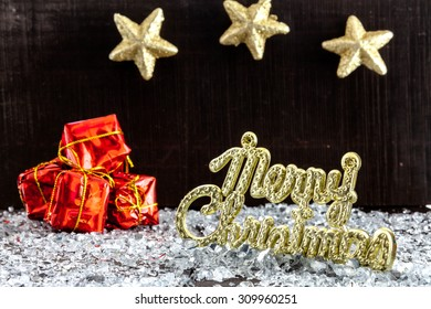 Set of decorative elements  like presents and stars on bright  snow on wooden background