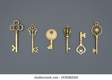 set of decorative gilded and aged keys made of copper or bronze, close-up, top view, flat lay, isolated on black background, group of plated vintage objects for decoration and design - Shutterstock ID 1935082043