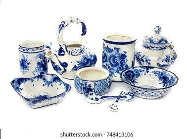 Set of decorative porcelain dishes, cups, plates, teapot with blue ethnic pattern Gzhel, traditional russian