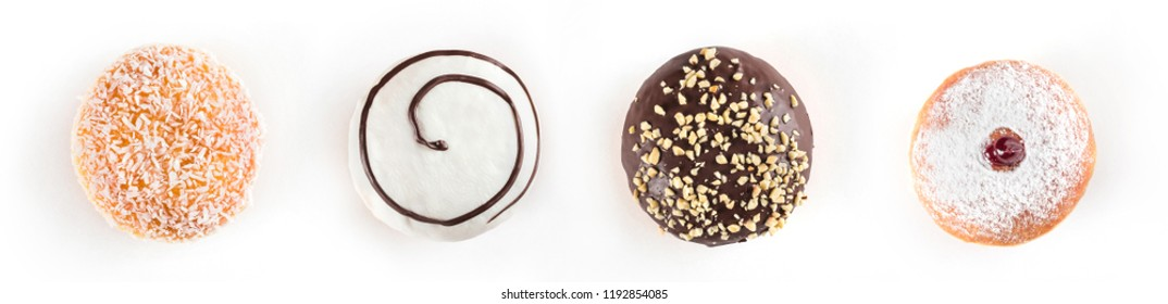 Set of delicious and assorted doughnuts isolated on white background, view from side