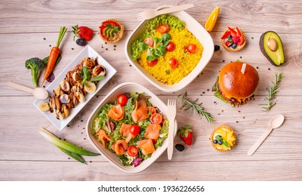 Set of delicious burgers with shredded meat and vegetables, salads and desserts