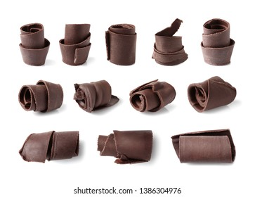 Set of delicious chocolate curls on white background