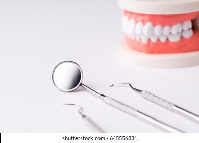 Set of Dentist's equipment tools, denture showing implant