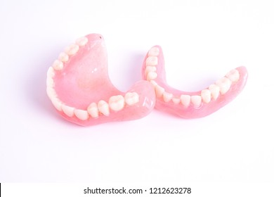 A set of dentures isolated on a white background.