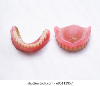 A set of Dentures Lies on the table