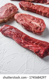 Set of denver, top blade, tri tip steak, machete, flank, bavette London broil marble beef on white background side view close up space view