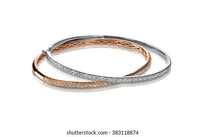 Set of diamond bracelets rose and white gold isolated on white with a shadow and reflection