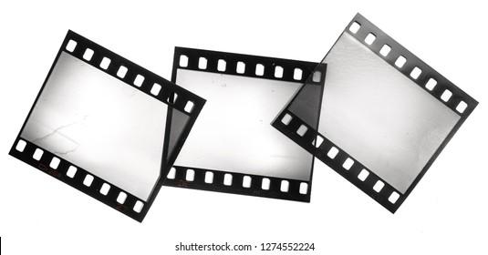 Set of different 35mm film strips on white background, film frames, border, macro photo, no scan