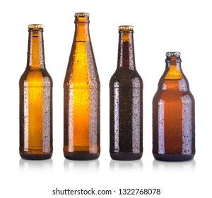 set of different beer bottles with water drops