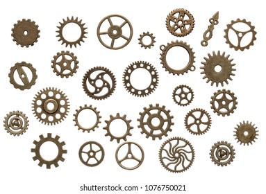 Set of different brass cog wheels isolated on white background