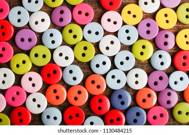 Set of different buttons for clothes, background. Top view, copy space.