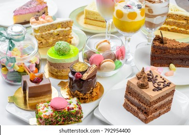Set of different cakes sweets and desserts arranged on one plate to celebration