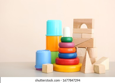 Set of different children's toys on a colored background. A place to insert text, minimalism. Baby background.