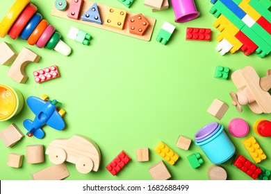 Set of different children's toys on a colored background top view. A place to insert text, minimalism. Baby background.