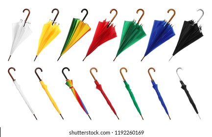 Set with different color umbrellas on white background