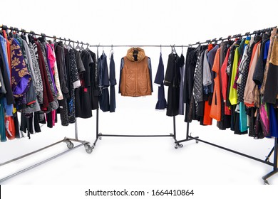 Set of different Colorful clothes on hangers against white background