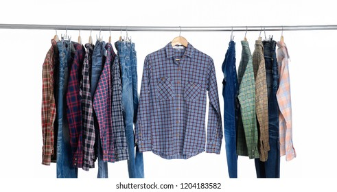 Set of different colorful cotton plaid shirts,clothes on wooden hangers