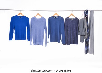 Set of different colorful sweater ,shirt ,scarf on hangers