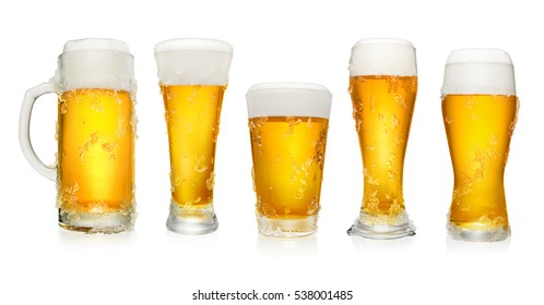 Set of different cups and glasses of beer isolated on white background