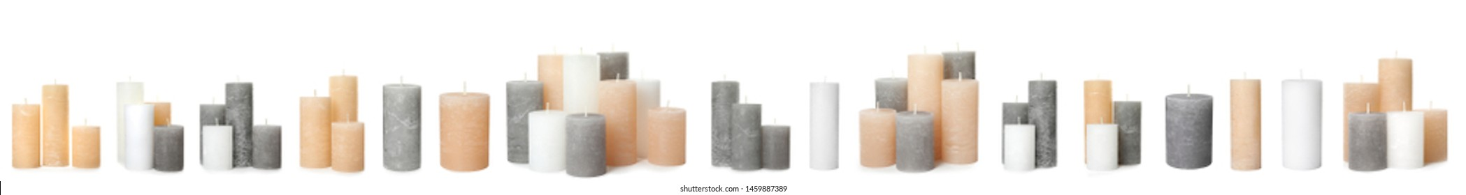 Set with different decorative wax candles on white background. Banner design