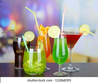 Set of different drinks on bright background